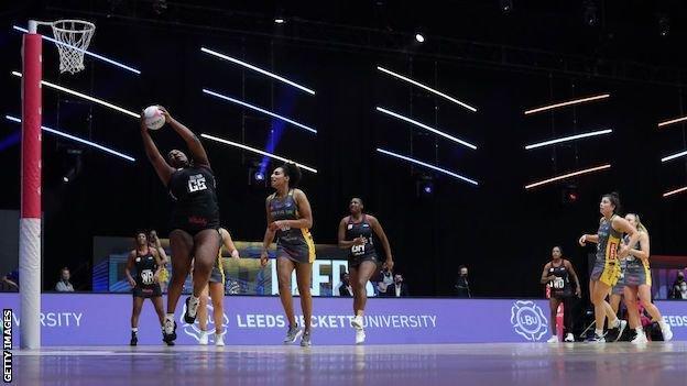 Britney Pringle-Clarke of Saracens Mavericks jumps with the ball during the match between Leeds Rhinos and Saracens Mavericks