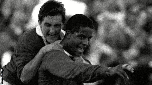 Robert Jones joins Jeremy Guscott in celebrating the Lions centre's winning try in the second 1989 Test against Australia