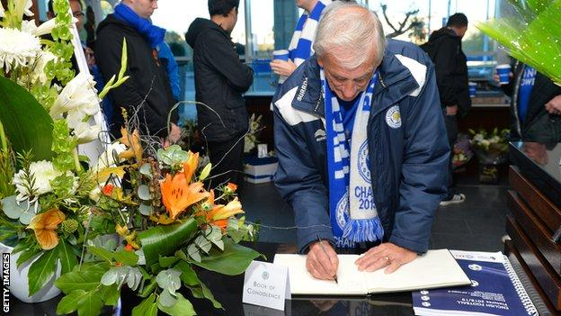 Leicester fan signs the book of condolence