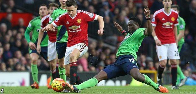 Victor Wanyama makes a tackle
