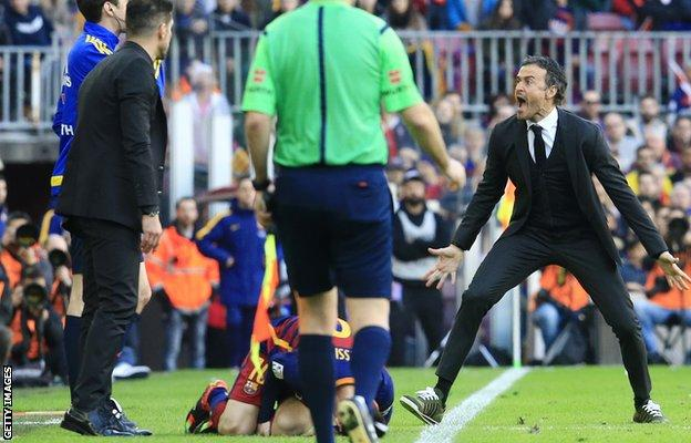 Barcelona manager Luis Enrique reacts to a foul on Lionel Messi