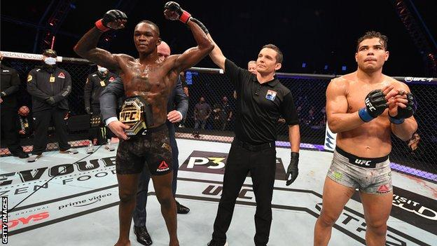 Israel Adesanya (left) celebrates his win over Paulo Costa at UFC 253