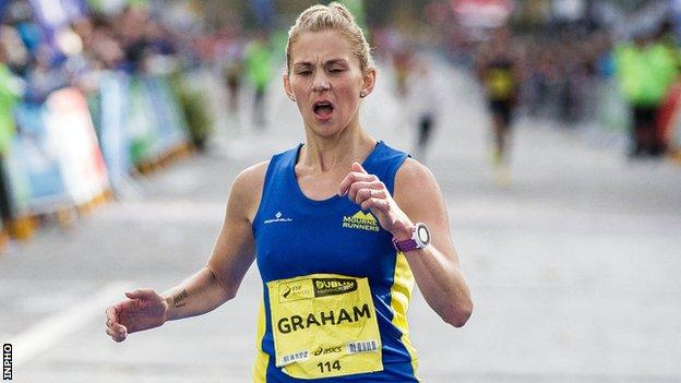 Laura Graham crossing the finishing line in Dublin in 2017