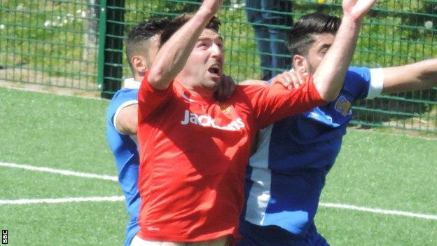 Craig Russell in action against Panjab FA
