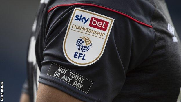 'Not Today or Any Day' logo on a Championship shirt