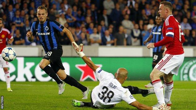 Manchester United striker Wayne Rooney scores against Club Brugge