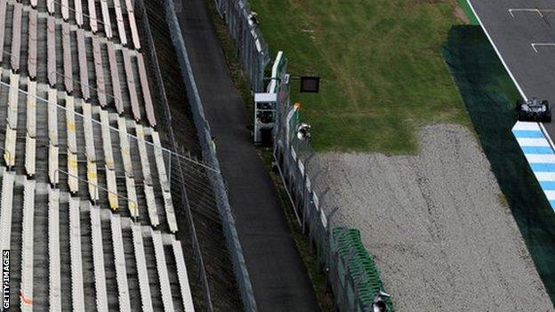 Lewis Hamilton drives past an empty grandstand during a practice session for the German Grand Prix in 2016