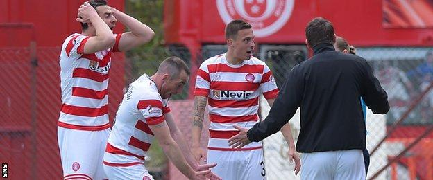 Hamilton players and manager Martin Canning complain about the first goal