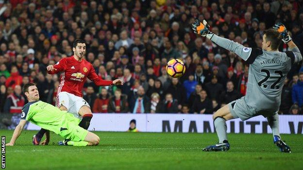 Liverpool keeper Simon Mignolet saves from Manchester United forward Henrikh Mkhitaryan
