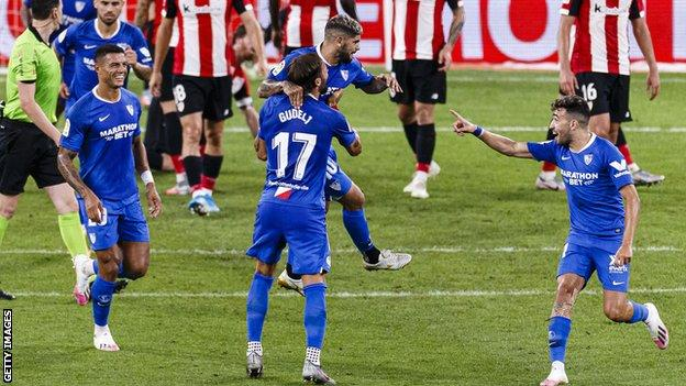 Ever Banega (centre, being lifted up) is congratulated by team-mates after scoring against Athletic Bilbao