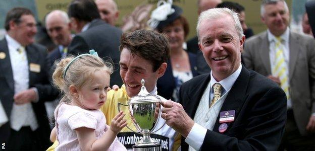 Jockey Dougie Costello and trainer Karl Burke (right) with the Commonwealth Cup