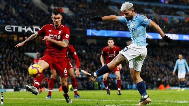 Sergio Aguero scores Manchester City's opening goal against Liverpool