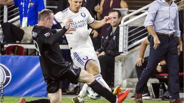 Wayne Rooney tackles Will Johnson