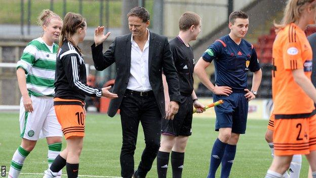 New Glasgow City manager Scott Booth congratulates his players after they beat Celtic 3-0
