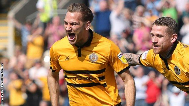 Mickey Demetriou (left) celebrates scoring the opening goal against Bury
