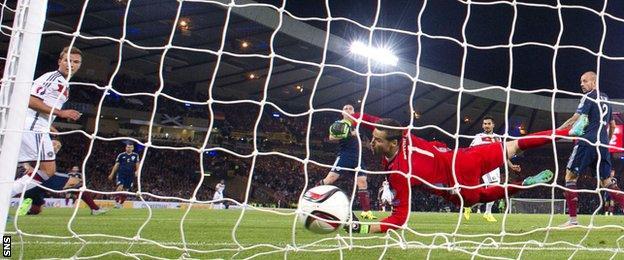 Scotland keeper David Marshall cannot stop Germany's Ilkay Gundogan from scoring