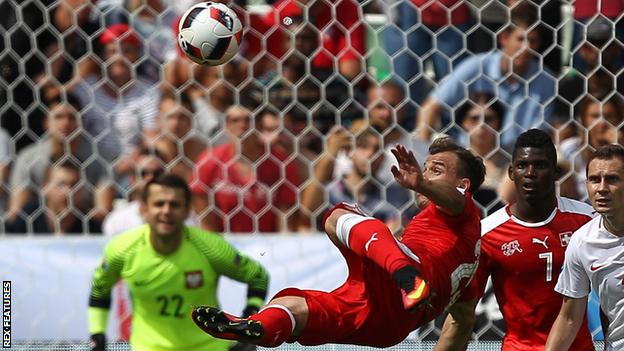 Xherdan Shaqiri equalises for Switzerland against Poland