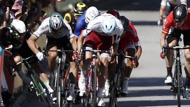 Mark Cavendish (far left) crashes with Peter Sagan next to him