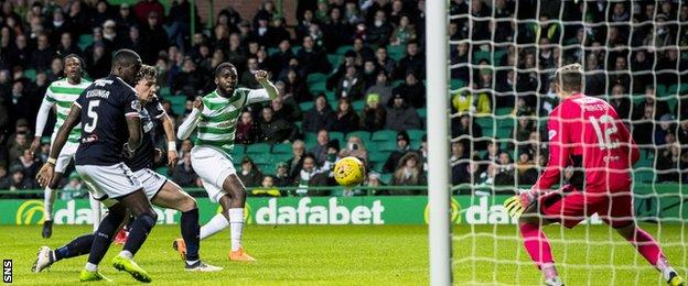 Odsonne Edouard watches his shot fly wide of the Dundee goal
