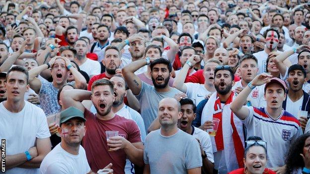 England fans watch their team play Colombia in London