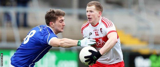 Cavan's Killian Clarke tackles Derry's Enda Lynn at the Athletic Grounds
