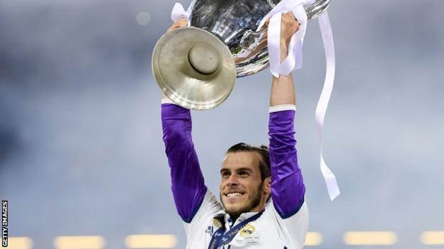 Gareth Bale lifts the Champions League trophy in his home city of Cardiff