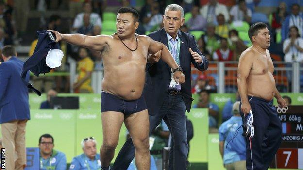 Mongolian wrestling coach protest