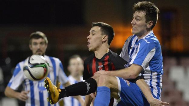 Crusaders winger Paul Heatley and Garth Falconer of Coleraine keep their eyes on the ball in Friday's league encounter at Seaview
