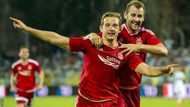 Peter Pawlett (left) put Aberdeen two ahead with a second half diving header