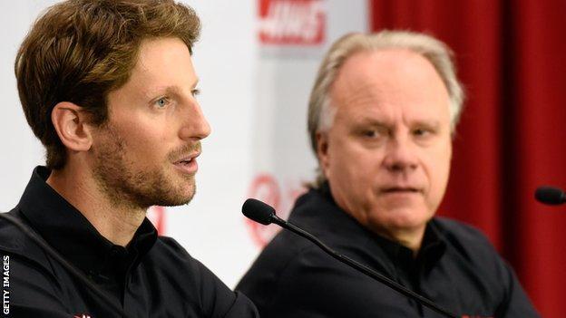 Romain Grosjean (left) with Gene Haas