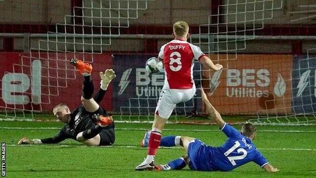 Mark Duffy scores for Fleetwood against Everton