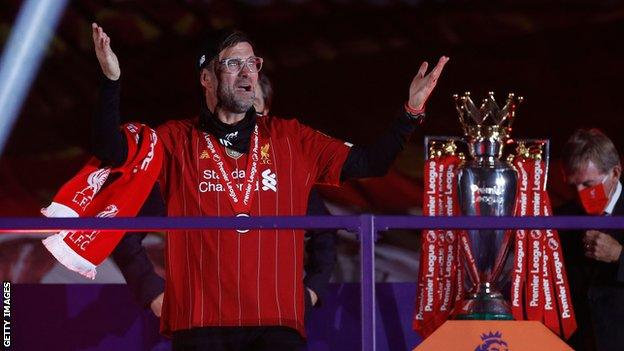 Jurgen Klopp next to the Premier League trophy