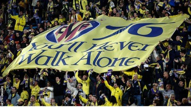 Villarreal fans carry banner