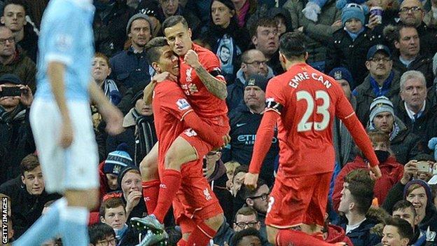 Liverpool's Philippe Coutinho celebrates scoring against Manchester City with team-mates Roberto Firmino and Emre Can
