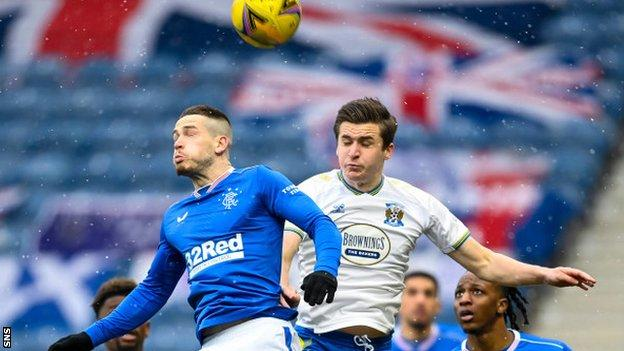 Rangers' Ryan Kent (left) rises for a high ball
