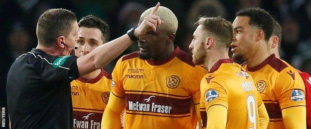 Referee Craig Thomson sends off Motherwell defender Cedric Kipre