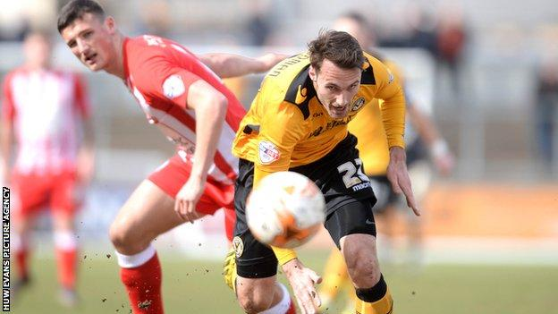 Alex Rodman of Newport County gets away from Matty Pearson