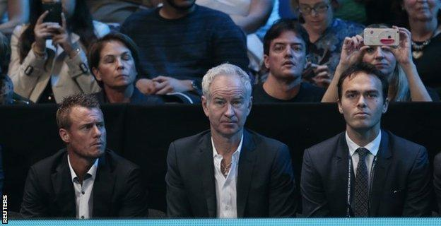 Australia's Lleyton Hewitt, John McEnroe and Great Britain's Ross Hutchins watch Andy Murray in action against Rafael Nadal
