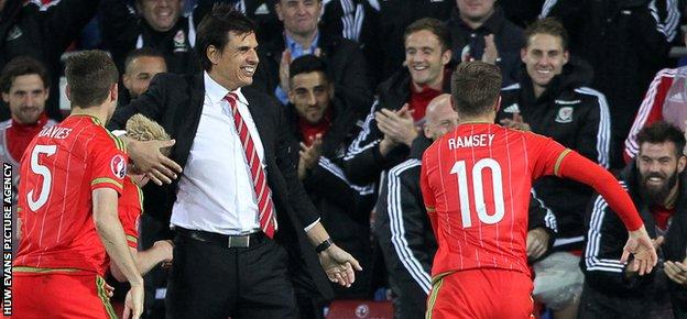 Scorer Aaron Ramsey rushed to celebrate with his Wales team-mates