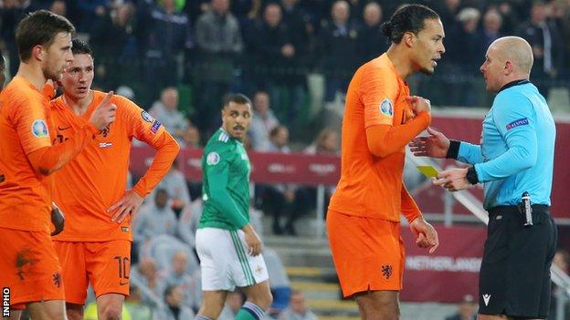 Virgil van Dijk protests to Polish referee Szymon Marciniak after he awarded Northern Ireland's first-half penalty