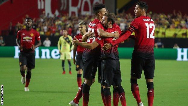 Juan Mata celebrates after scoring in pre-season