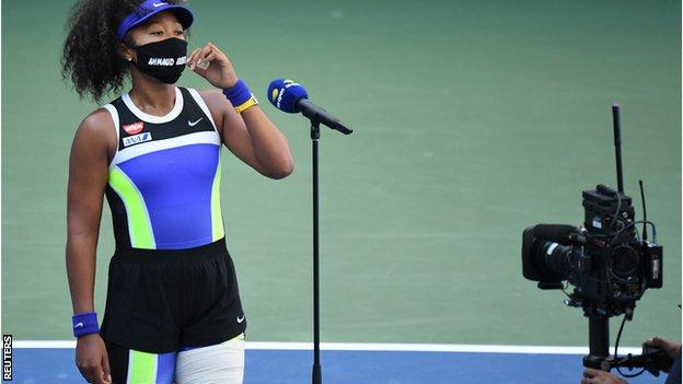 Naomi Osaka wearing a face mask bearing the name of Ahmaud Arbery, a black man who was shot dead while jogging in Georgia in February.