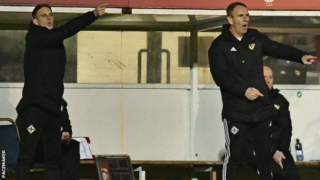 Manager Kenny Shiels (right) and son Dean, who is the squad's coach, shout out instructions to the Northern Ireland players in Tuesday's game