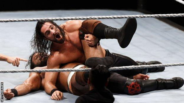 Rollins (top) in action with Jinder Mahal
