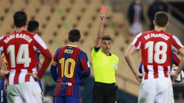 Lionel Messi is shown a red card in the Spanish Super Cup final