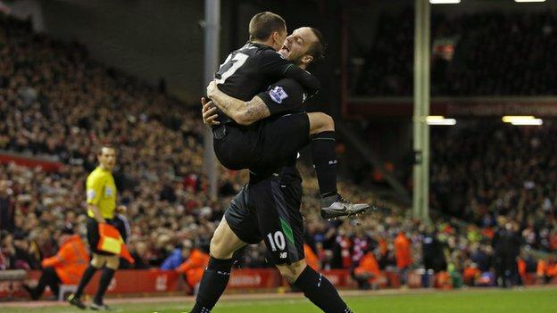 Bojan Krkic (left) helps to celebrate Marko Arnautovic's goal at Anfield in the Capital One Cup semi-final second leg