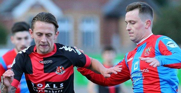 Matthew Snoddy of Crusaders in action against Kyle Cherry of Ards