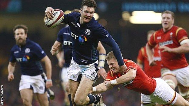 Duncan Taylor evades Gareth Anscombe's tackle before scoring Scotland's second try against Wales