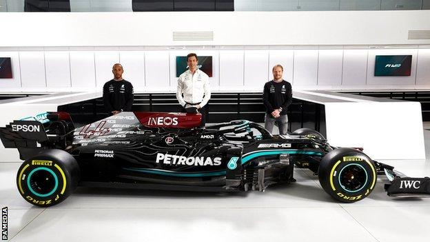 Team principal and CEO Toto Wolff with drivers Sir Lewis Hamilton and Valtteri Bottas alongside the Mercedes-AMG F1 W12 E Performance