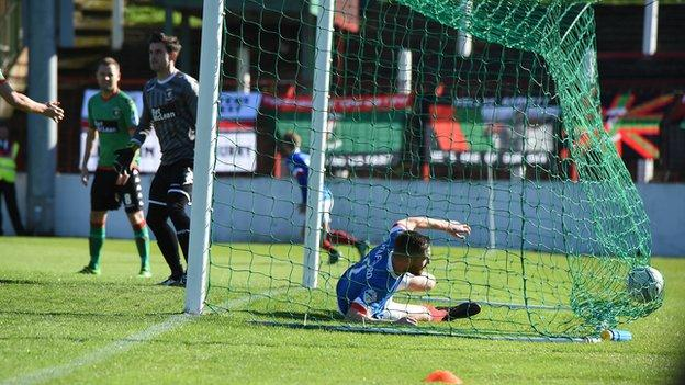The ball hits the back of Glentoran's as the Blues go in front through a Marcus Kane own goal